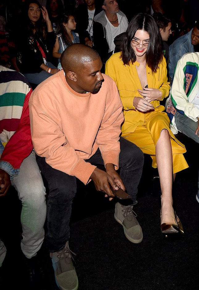 Kanye West Wearing Yeezy Season 3 Sweatshirt, Acne Studios Ace Used Cash And Yeezy Boost 750