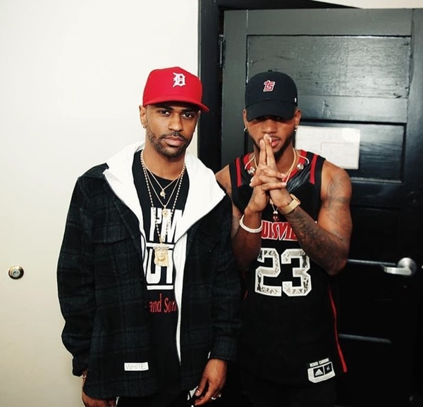 Big Sean Wearing A John Elliott Jacket, Carhartt Hoodie, Yeezy Boots And Goyard Luggage 01