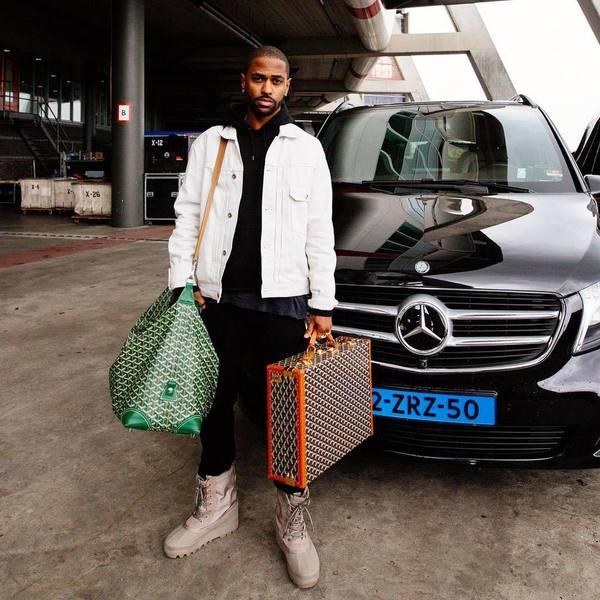 Big Sean Wearing A John Elliott Jacket, Carhartt Hoodie, Yeezy Boots And Goyard Luggage 02