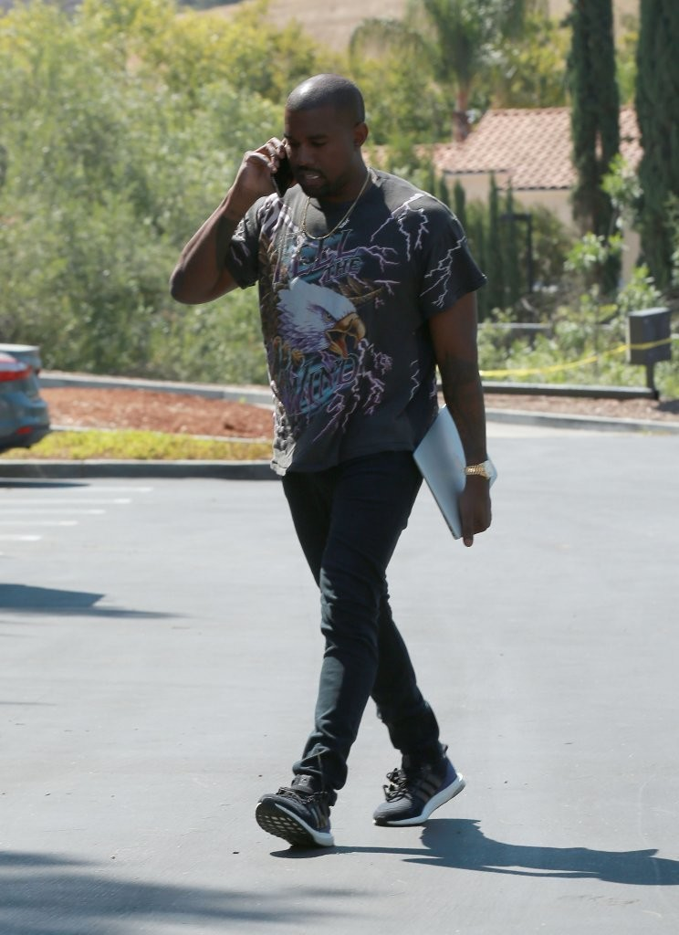 Kanye West Wearing A Vintage Daytona Beach T-shirt, Acne Studios Jeans And Adidas Boost Sneakers
