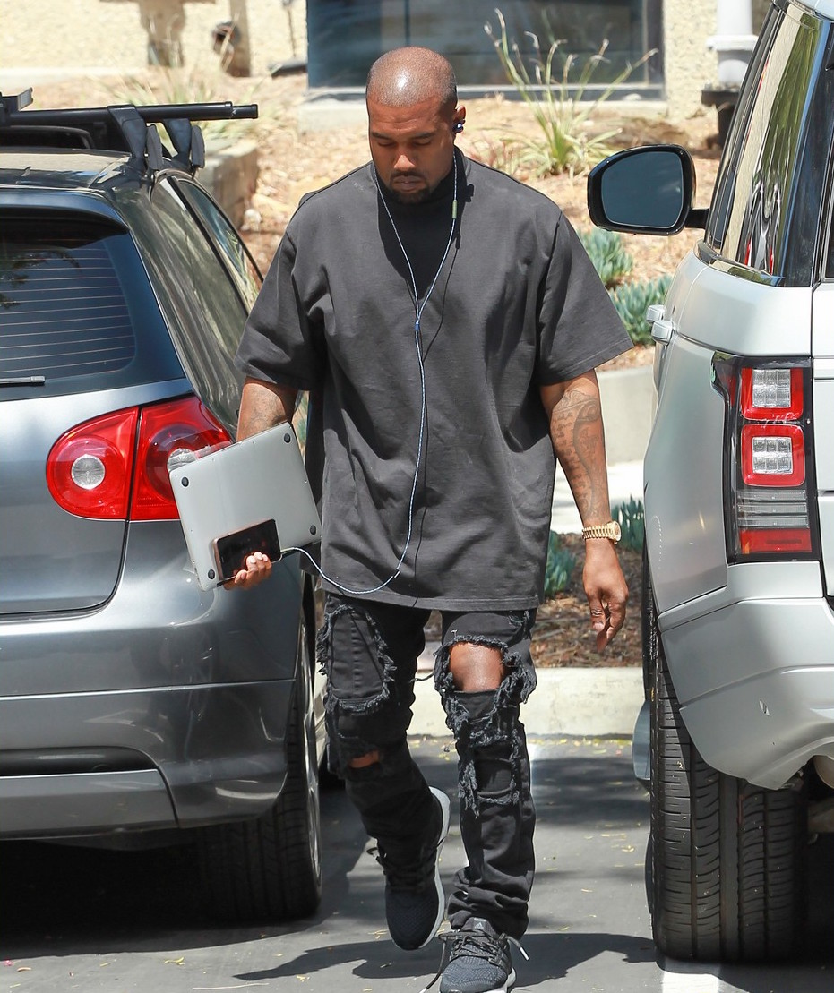 50d178214ebe2 Kanye West Wearing Faith Connexion Jumpsuit And Adidas Boost Sneakers. Kanye  West