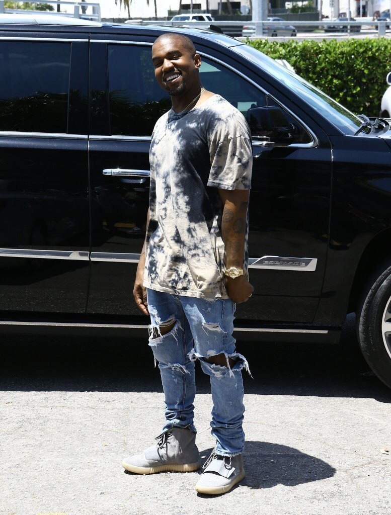 Kanye West Wearing Fear of God Jeans And Yeezy Boost 750 Sneakers