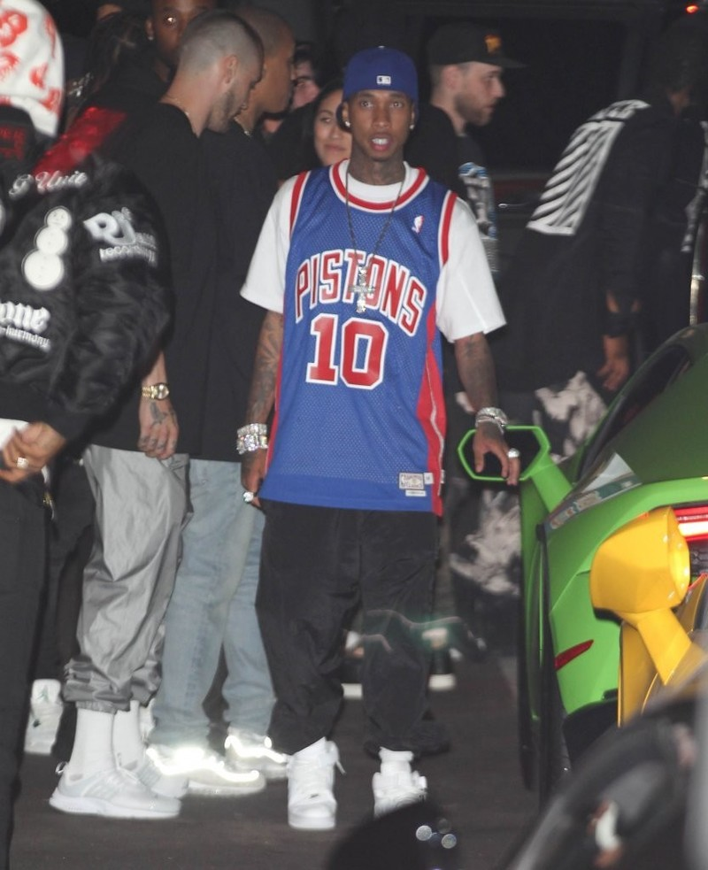 Tyga Wearing Vintage Dennis Rodman Piston's Jersey, Baggy Black Pants And Nike Air Force 1 High