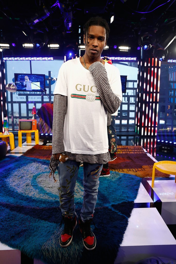 ASAP Rocky Wearing Gucci T-Shirt, Jeans And Air Jordan 1