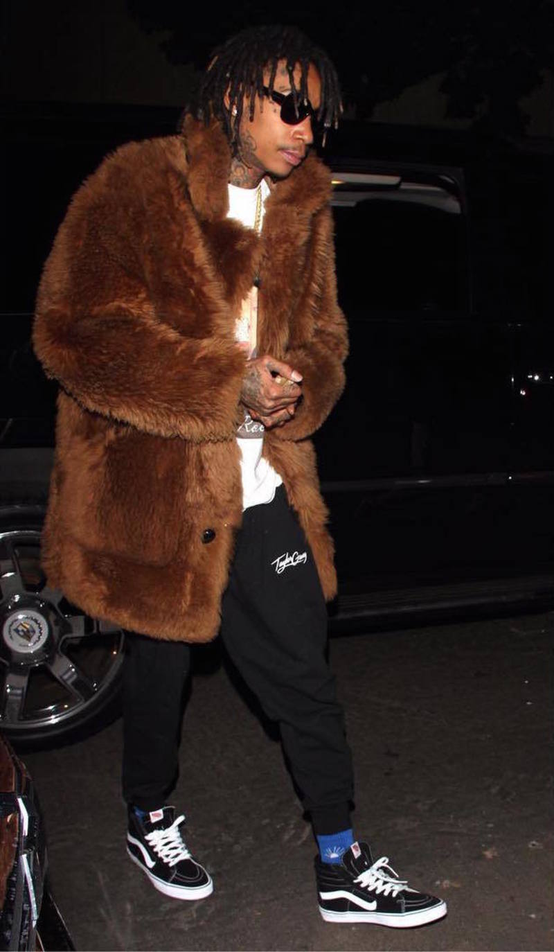 Wiz Khalifa Wearing Coach 1941 Reversible Shearling Fur Coat, Gosha Rubchinskiy Socks and Vans Sneakers